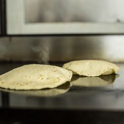 Next, the tortillas hit the grill. If they puff up, as shown above, it is said by the staff to foretell love or impending marriage.
