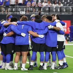 BYU players pause during warmups in Allegiant Stadium prior to the Vegas Kickoff Classic between BYU and Arizona in Las Vegas on Saturday, Sept. 4, 2021.