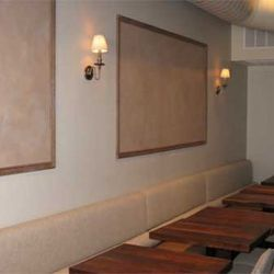 Frames and sconces line the wall