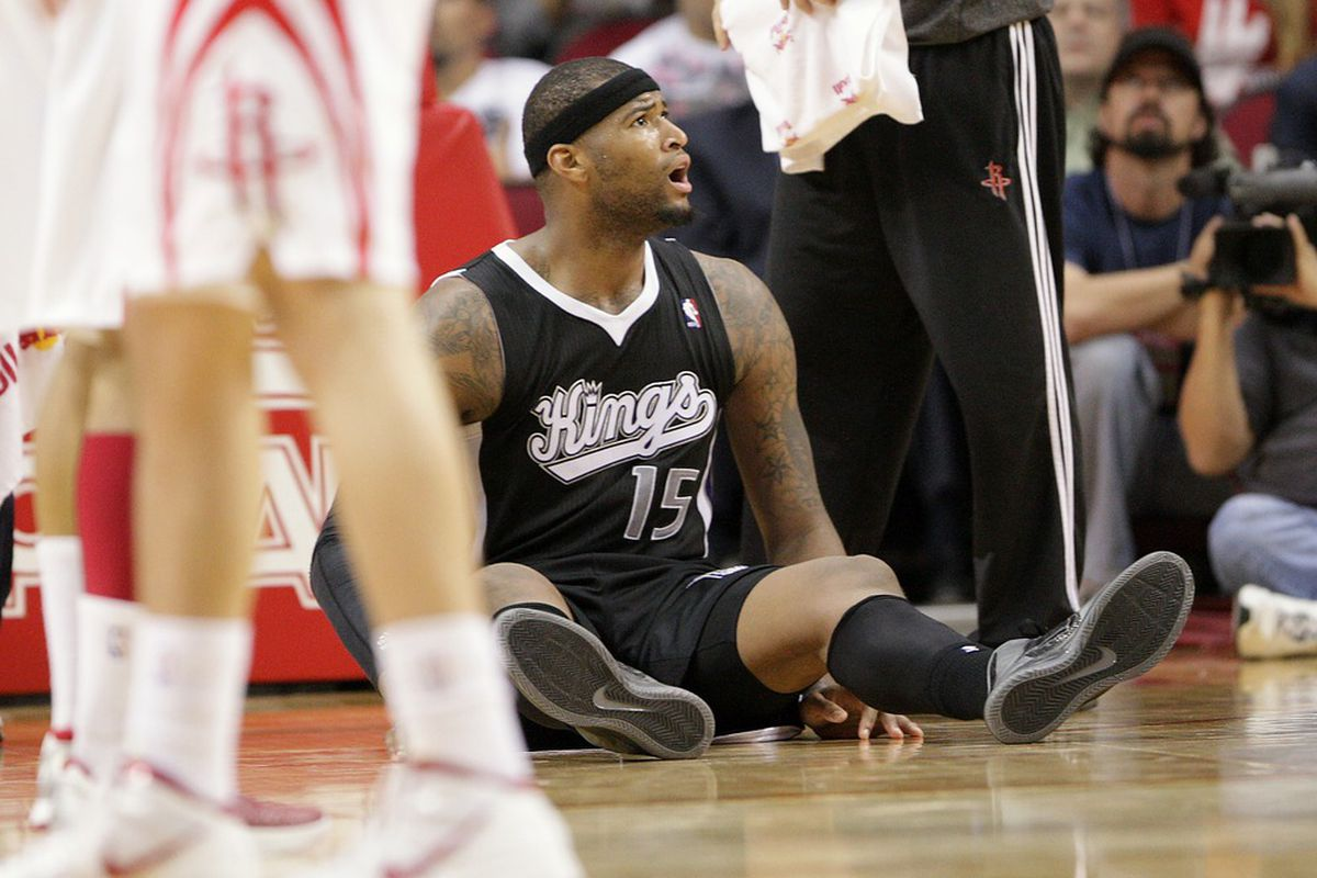 March 26, 2012; Houston, TX, USA; Sacramento Kings center DeMarcus Cousins (15) reacts after a call in overtime against the Houston Rockets at the Toyota Center. The Rockets won 113-106. Mandatory Credit: Troy Taormina-US PRESSWIRE