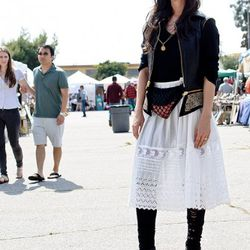 """<a href=""""http://la.racked.com/archives/2011/06/07/raquel_at_the_melrose_trading_post.php"""" rel=""""nofollow"""">Raquel</a>'s sweater and leggings are by Raquel Allegra, the vest is by Stand and Deliver, and the shoes and belt bag are vintage."""