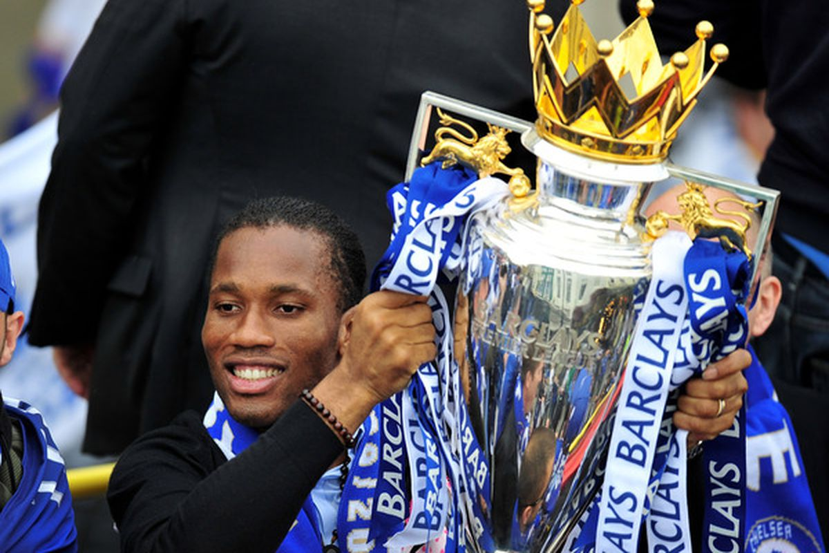 Didier Drogba injures his elbow holding up Chelsea's ill-earned trophy. Kidding. Mostly. (Photo by Clive Mason/Getty Images)