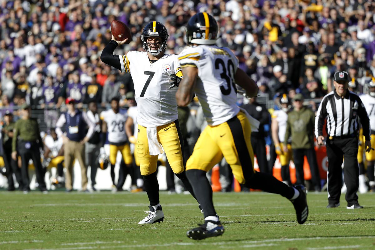 Quarterback Ben Roethlisberger of the Pittsburgh Steelers throws a touchdown to running back James Conner in the first quarter against the Baltimore Ravens at M&T Bank Stadium on November 4, 2018 in Baltimore, Maryland.