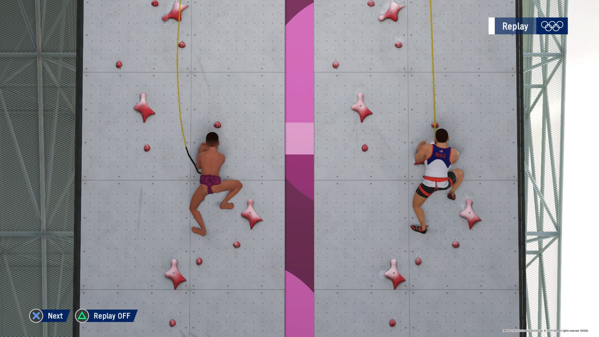 a rock climber scales a competition wall wearing a sumo wrestler's signature belt in Olympic Games Tokyo 2020