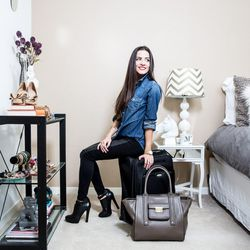 Maria is ready to go with a carry on and roomy handbag that fits her laptop.