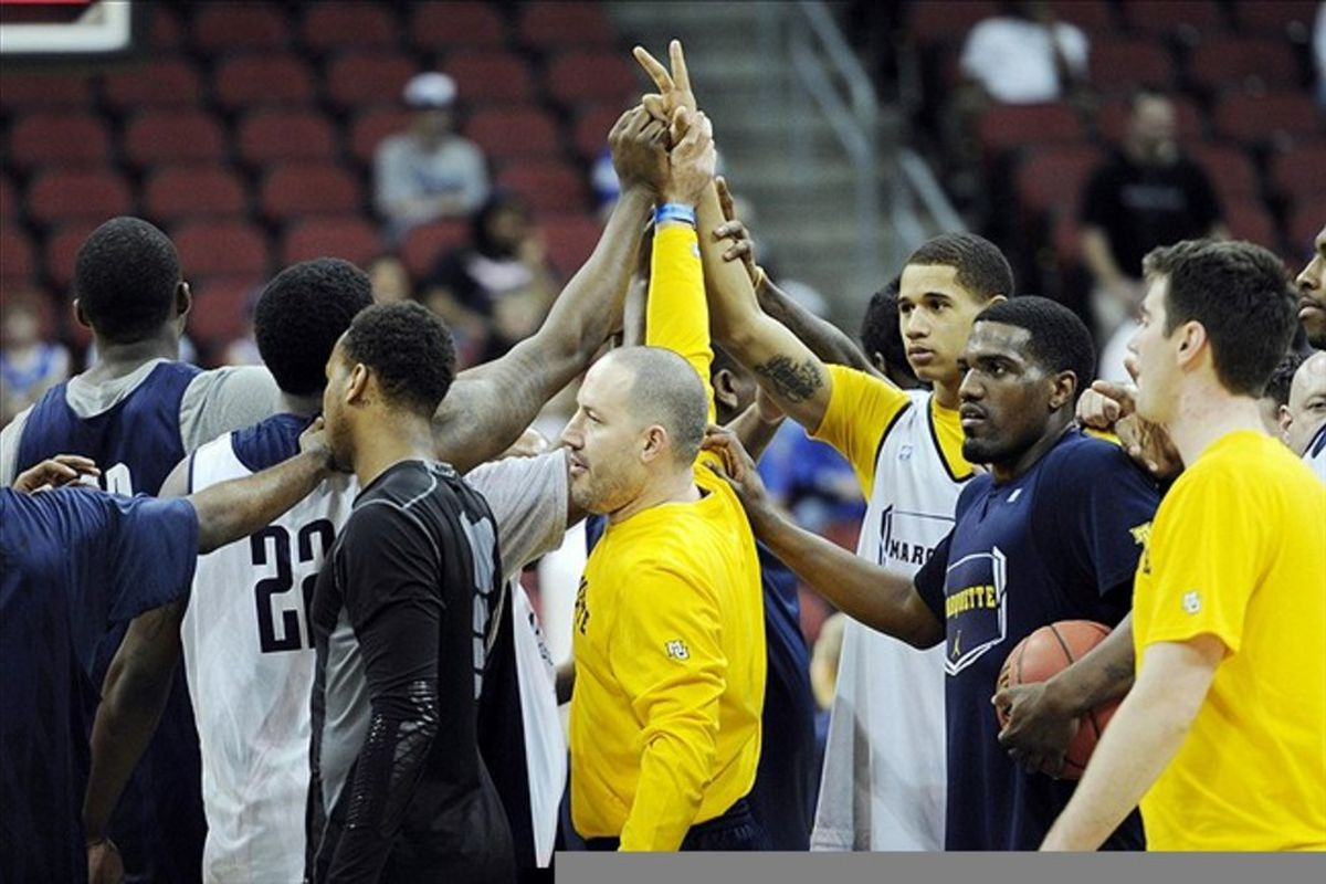 Mar 14, 2012; Louisville, KY, USA; Marquette Golden Eagles head coach Buzz Williams leads a huddle during practice for the second round of the 2012 NCAA men's basketball tournament at the KFC Yum! Center.  Mandatory Credit: Jamie Rhodes-US PRESSWIRE