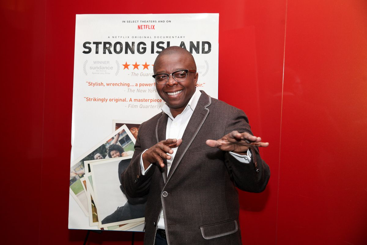 Yance Ford poses with a poster for his movie 'Strong Island'