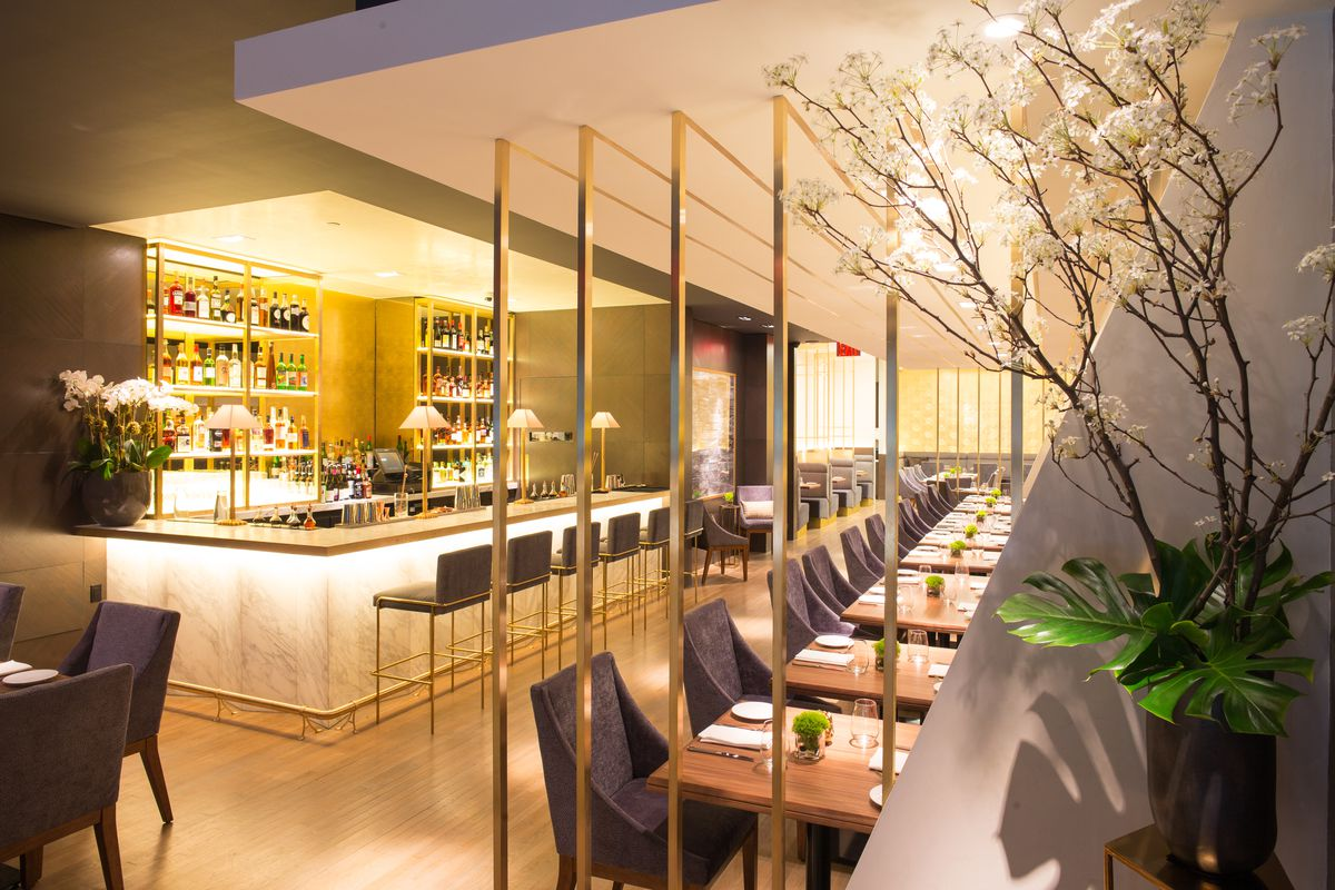 The bar at Indian Accent with gold lighting