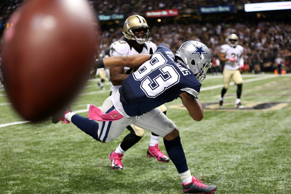 NEW ORLEANS, LA - New Orleans Saints cornerback Delvin Breaux (40) deflects a pass away from Dallas Cowboys wide receiver Terrance Williams (83) in the end zone during a 2015 game at the Mercedes-Benz Superdome.