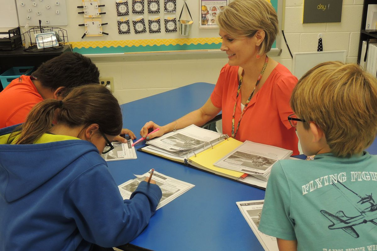 Cathy Whitehead, Tennessee's 2015-16 Teacher of the Year, works with her third-grade students at West Chester Elementary School in Henderson.