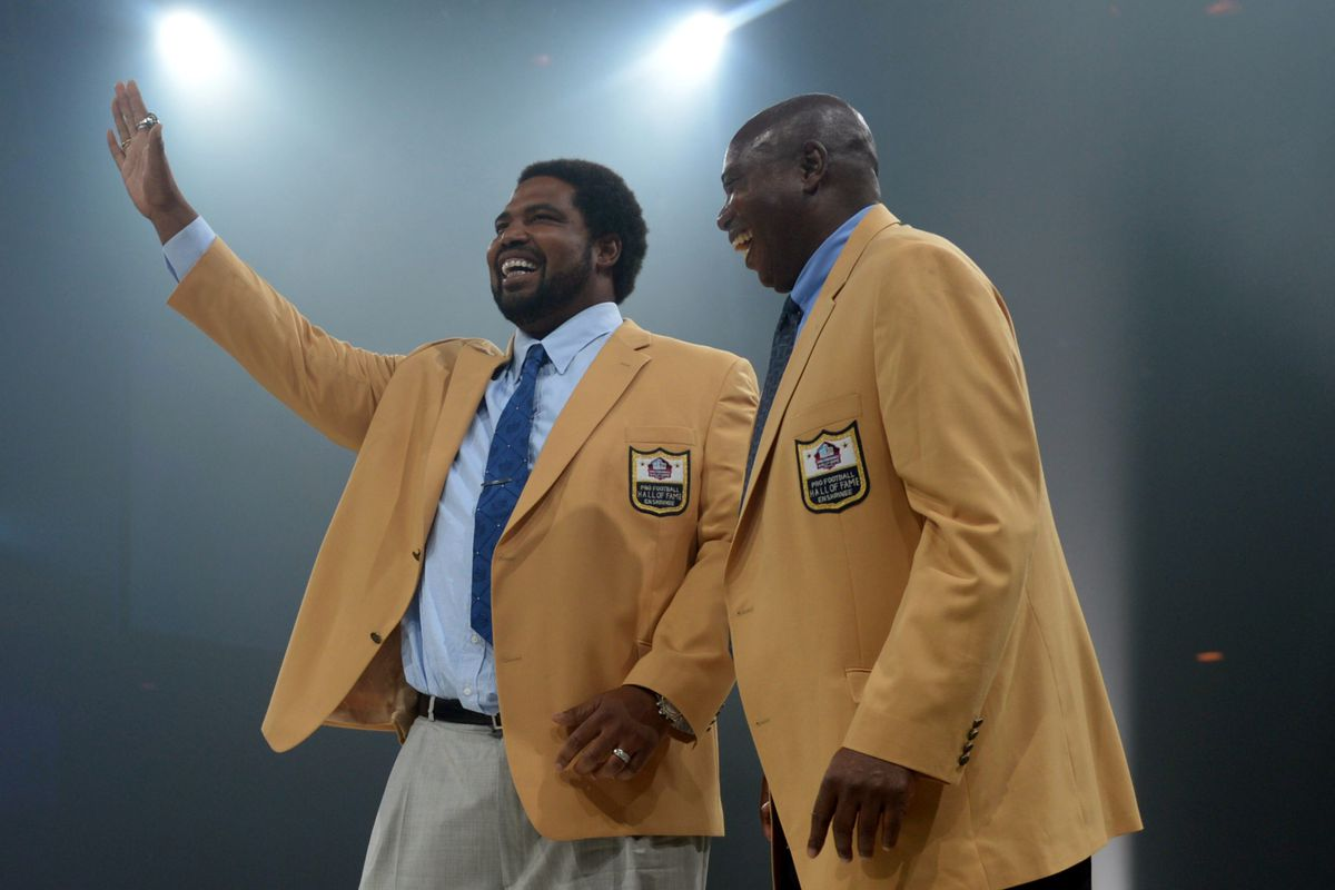 Jonathan Ogden, set for Hall of Fame induction Saturday night, gets his gold jacket from Ozzie Newsome a day before.