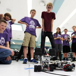 """Students watch as robots compete in a """"sumobot"""" competition as middle school students who have been involved in an after-school STEM program compete in West Jordan on Wednesday, May 27, 2015."""