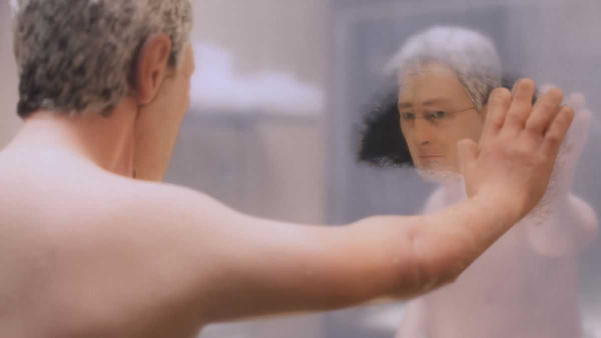 A puppet man looks at himself in a mirror