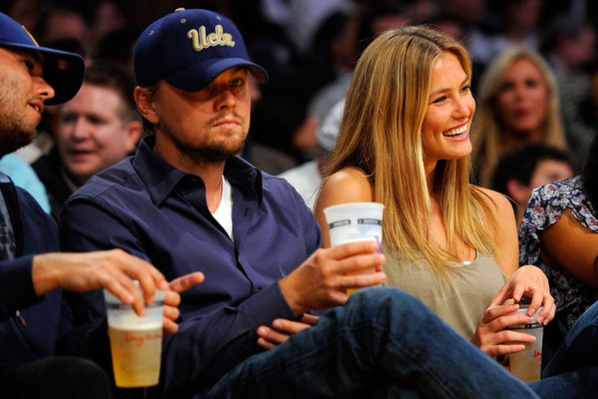Inception star Leonardo DiCaprio sits courtside at Game 2 of the 2010 Western Conference playoffs, drinking a beer and wearing an ugly-ass hat.  (Photo by Kevork Djansezian/Getty Images)