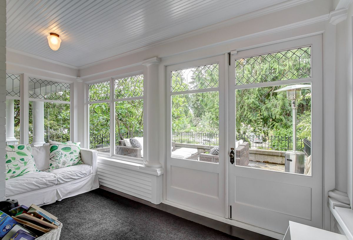 A white mudroom with French doors.