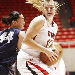 Utah's Taryn Wicijowski, right, spins around Utah State's Franny Vaaulu as Utah and Utah State play Nov. 27, 2012, in the Huntsman Center. Utah won 92-64.