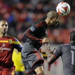 Toronto FC midfielder Jackson Goncalves (11) heads the ball in front of Real Salt Lake forward Alvaro Saborio (15) and Toronto FC defender Doneil Henry (15) during a game at Rio Tinto Stadium in Sandy on Saturday, March 29, 2014.
