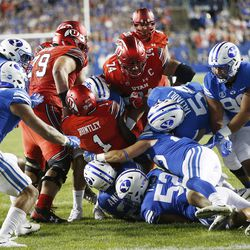 Utah Utes quarterback Tyler Huntley (1) is wrapped up by the Brigham Young Cougars defense in Provo on Saturday, Sept. 9, 2017.