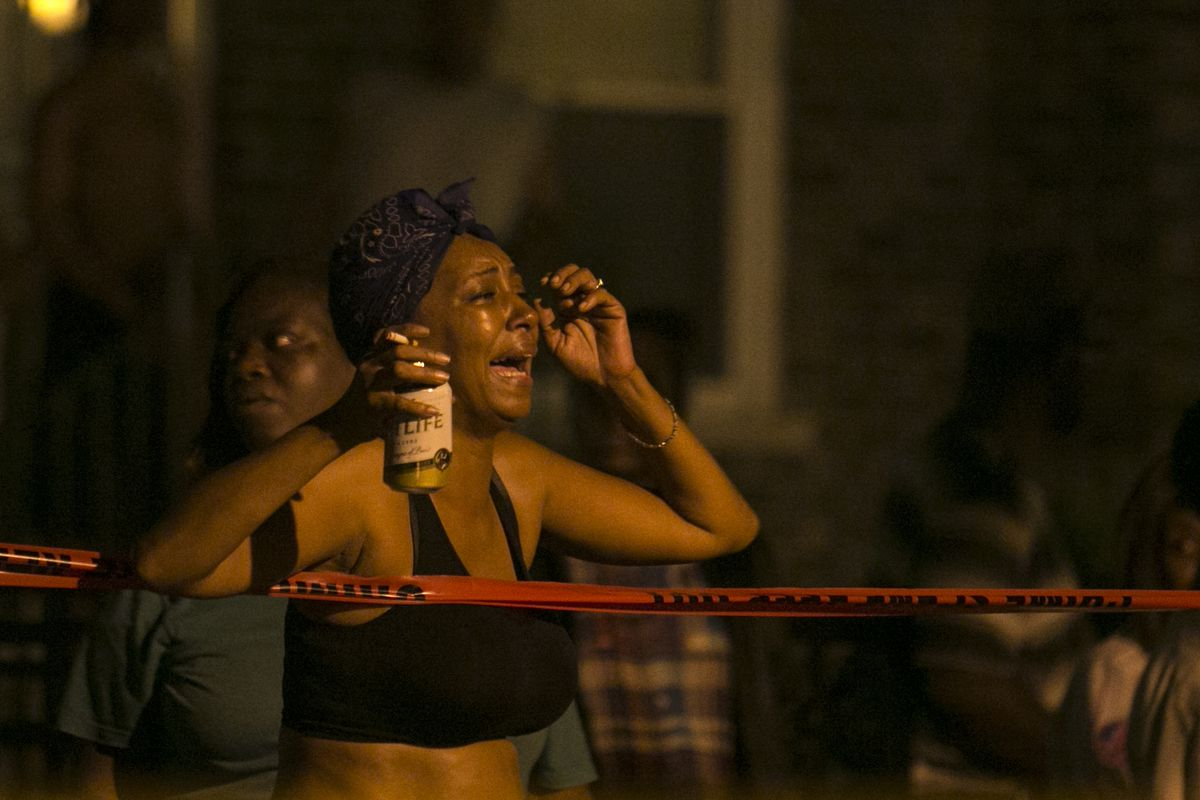 A woman reacts to a fatal shooting early Tuesday in the 300 block of West 42nd Street.   Ashlee Rezin/For the Sun-Times