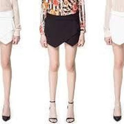 """This Zara skort has been a huge style blogger darling for a few months now, and with good reason: The barely-there length is far less risky when the shorts sit underneath the origami-style skirt. $49.90, <a href=""""http://www.zara.com/us/en/woman/skirts/min"""