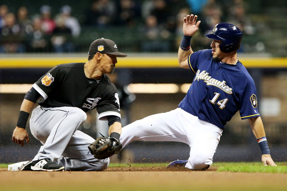 Hernan Perez of the Brewers steals second base as the White Sox' Tyler Saladino applies a late tag at Miller Park Friday. (Getty Images)