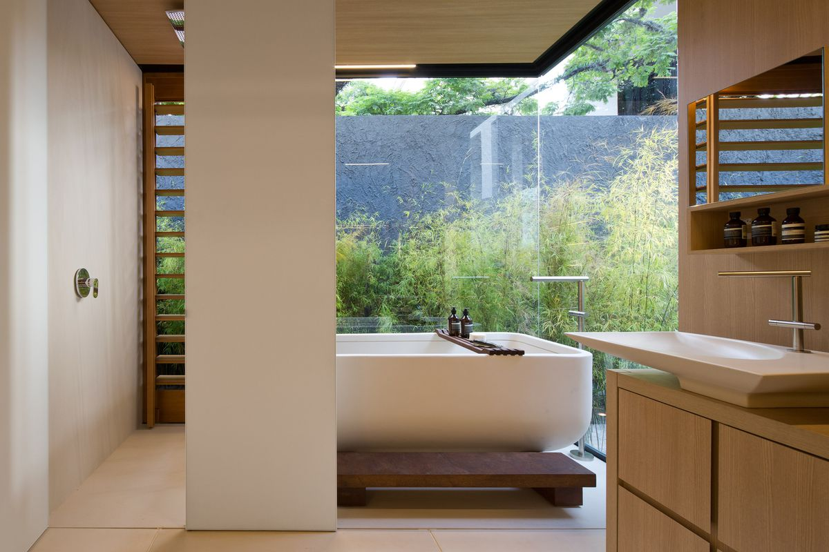 Bathroom with big white tub and natural colors