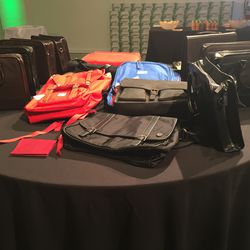 Men's bags, including the Wall + Water briefcase at right for $69 (was $275)