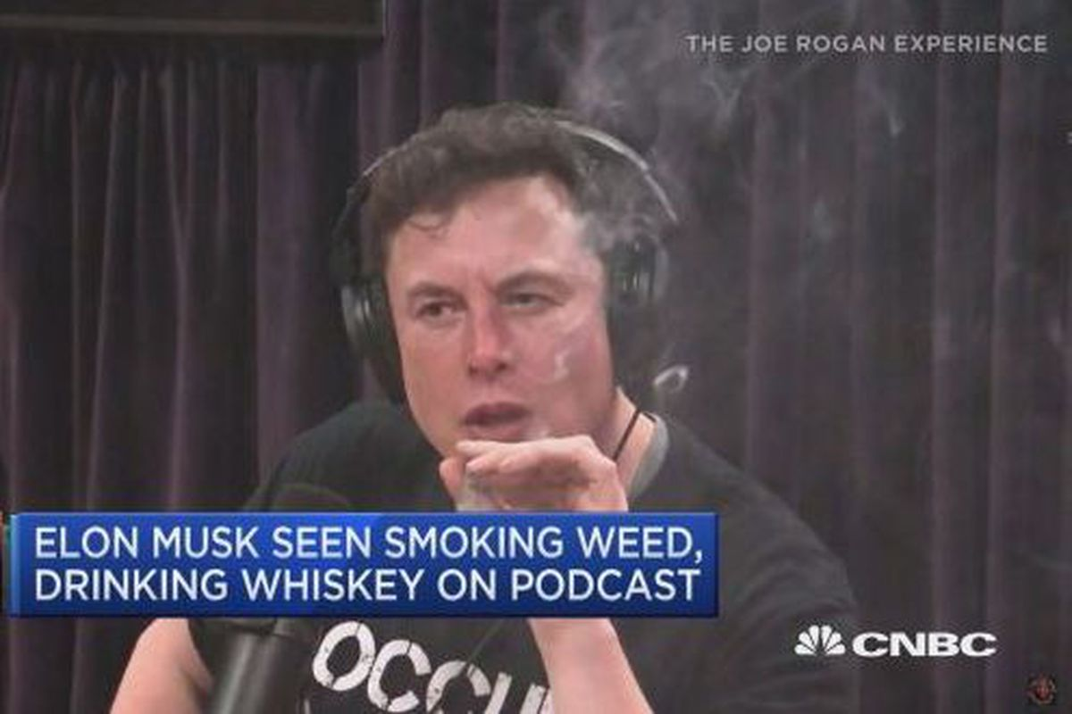 """Screenshot of Tesla CEO Elon Musk on the Joe Rogan podcast smoking a blunt. The caption reads, """"Elon Musk seen smoking weed, drinking whiskey on podcast."""""""