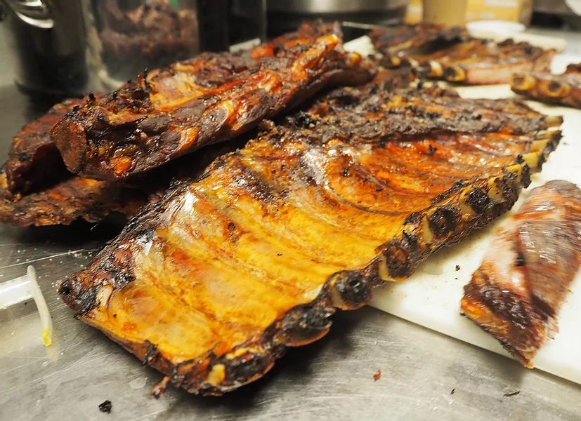 A close-up image of barbecued ribs at the Barbeque Pit