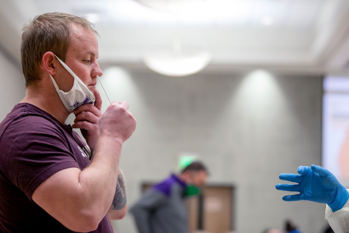 James Bockas self-administers a COVID-19 test as Weber State University begins the first day of widescale testing for students and employees at the Ogden campus on Tuesday, Nov. 10, 2020. Weber State had previously offered free testing for anyone with possible coronavirus symptoms. The new process will allow for free rapid testing for thousands of people even if they aren't showing symptoms.