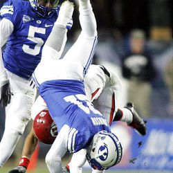 Scott Johnson of BYU (upside down) breaks up a pass intended for David Reed of Utah during the second half of play at LaVell Edwards Stadium in Provo Saturday. BYU won in overtime 26-23.