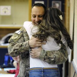 Sydney Goettig jumps into the arms of her father, Air Force Tech Sgt. Edward Goettig, who surprised her with his early return at Lehi Junior High School on Thursday, March 6, 2014. Goettig had been deployed to Afghanistan since Aug. 27, 2013.