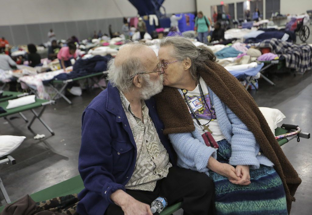 Don and Peg Sauter kiss as they take refuge from Tropical Storm Harvey at the George R. Brown Convention Center in Houston on Tuesday, Aug. celebrated their 55th wedding anniversary on Aug. 22 and moved from their assisted living home. | Elizabeth Conley/