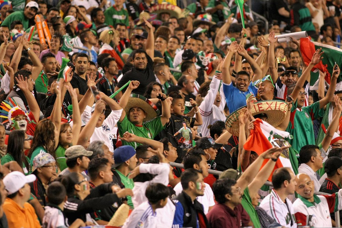 DENVER, CO - JUNE 01:  Fans of Mexico celebrate as Mexico defeated New Zealand in their international friendly at INVESCO Field at Mile High on June 1, 2011 in Denver, Colorado.  (Photo by Doug Pensinger/Getty Images)