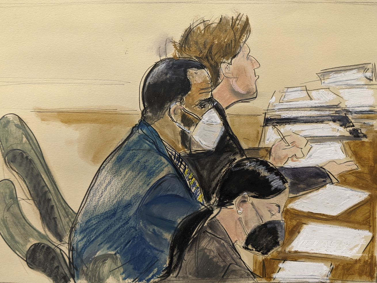 In this courtroom artist's sketch R. Kelly (left) listens during his trial in New York in August.