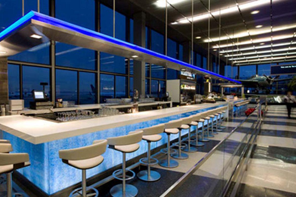 A long sushi bar inside an airport terminal.
