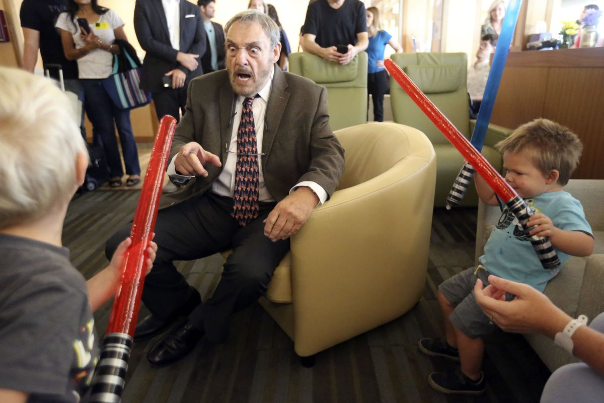 "Axel Erickson, left, and Jay Williams, right, draw their lightsabers on John Rhys-Davies from ""The Lord of the Rings"" trilogy, ""Raiders of the Lost Ark,"" ""Indiana Jones and the Last Crusade,"" ""The Shannara Chronicles"" and the ""Gargoyles"" TV series, at Primary Children's Hospital in Salt Lake City on Thursday, Sept. 5, 2019."