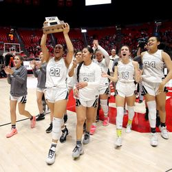 Highland's Kaija Glasker holds up the championship trophy as the Rams celebrate their win over Springville in the 5A State Basketball Championship in the Huntsman Center at the University of Utah in Salt Lake City on Saturday, Feb. 29, 2020. Highland won 46-34.