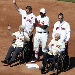 Former Boston Red Sox catcher Jason Varitek, top left, stands with, current designated hitter David Ortiz, top center, former pitcher Tim Wakefield, top right, and former players Bobby Doerr, seated right, and Johnny Pesky, seated left, on the field during ceremonies to celebrate the 100th anniversary of a regular season baseball game at Fenway Park before the game between the New York Yankees and the Red Sox in Boston, Friday, April 20, 2012.