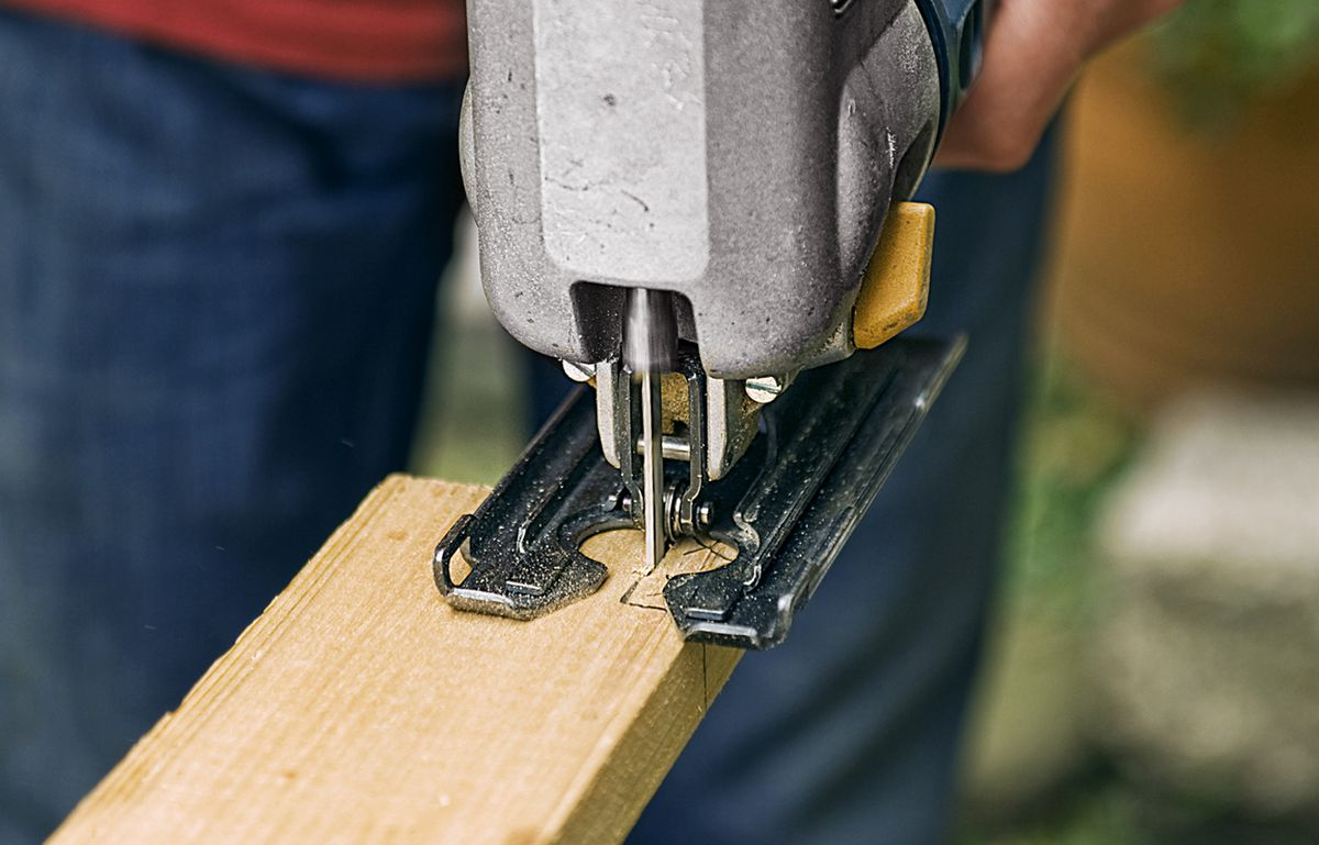 Man Notches End Pieces To Fit Trellis Legs Of Planter Box