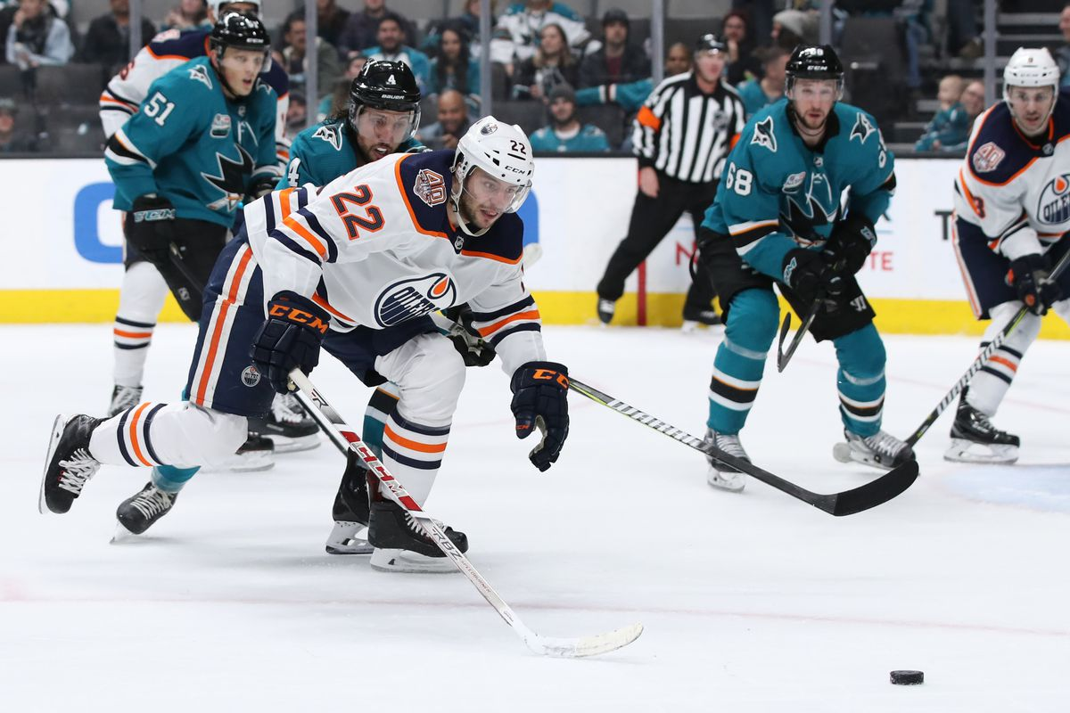 Jan 8, 2019; San Jose, CA, USA; Edmonton Oilers right wing Tobias Rieder (22) chases after the puck while being pursued by San Jose Sharks defenseman Brenden Dillon (4) during the third period at SAP Center at San Jose.