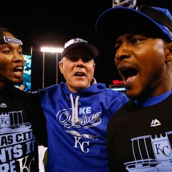 Alcides Escobar #2 of the Kansas City Royals, manager Ned Yost #3 of the Kansas City Royals, and Jarrod Dyson #1 of the Kansas City Royals celebrate after the Kansas City Royals defeat the Houston Astros 7-2 in game five of the American League Divison Series at Kauffman Stadium on October 14, 2015 in Kansas City, Missouri.