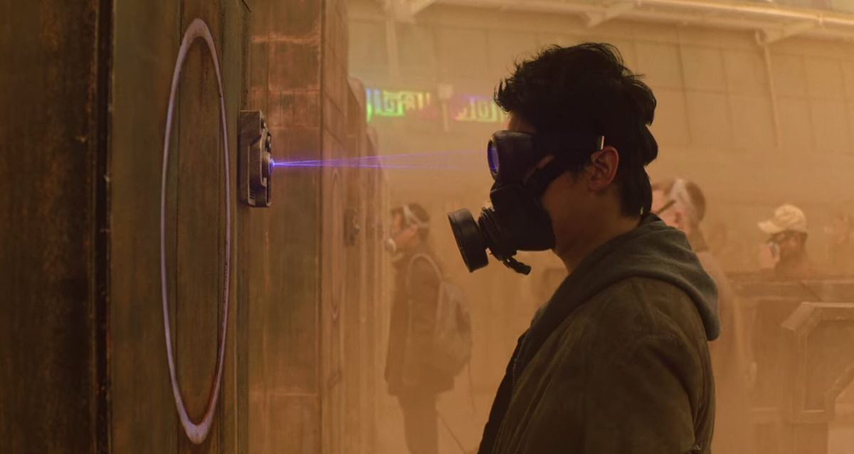 A man in a gas mask gets his eye scanned in Space Sweepers