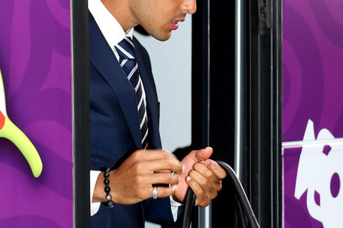 KRAKOW, POLAND - JUNE 06:  Theo Walcott arrives with the England team at their team hotel ahead of EURO 2012 on June 6, 2012 in Krakow, Poland.  (Photo by Scott Heavey - The FA - Pool/Getty Images)
