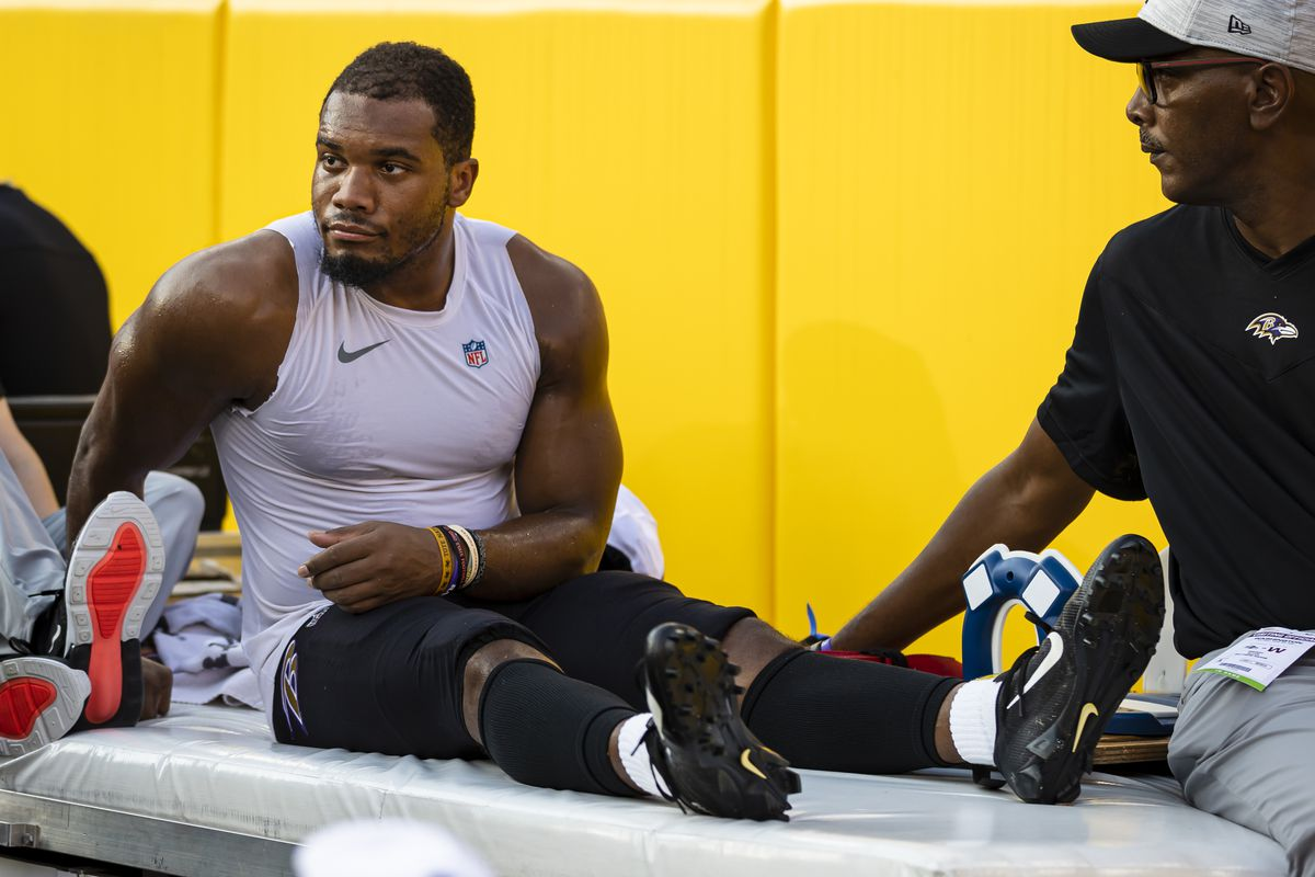 J.K. Dobbins #27 of the Baltimore Ravens is carted off the sidelines after being injured against the Washington Football Team during the first half of a preseason game at FedExField on August 28, 2021 in Landover, Maryland.