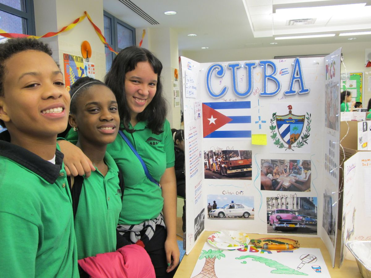 Haley Alonso, right, with classmates, said she'd never spoken to her father about his journey from Cuba before the project.