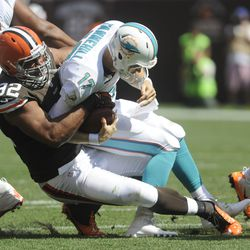 Sep 8, 2013; Cleveland, OH, USA; Cleveland Browns defensive tackle Desmond Bryant (92) sacks Miami Dolphins quarterback Ryan Tannehill (17) during the second quarter at FirstEnergy Stadium.
