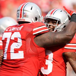 Chris Carter and Kenny Guiton celebrate.