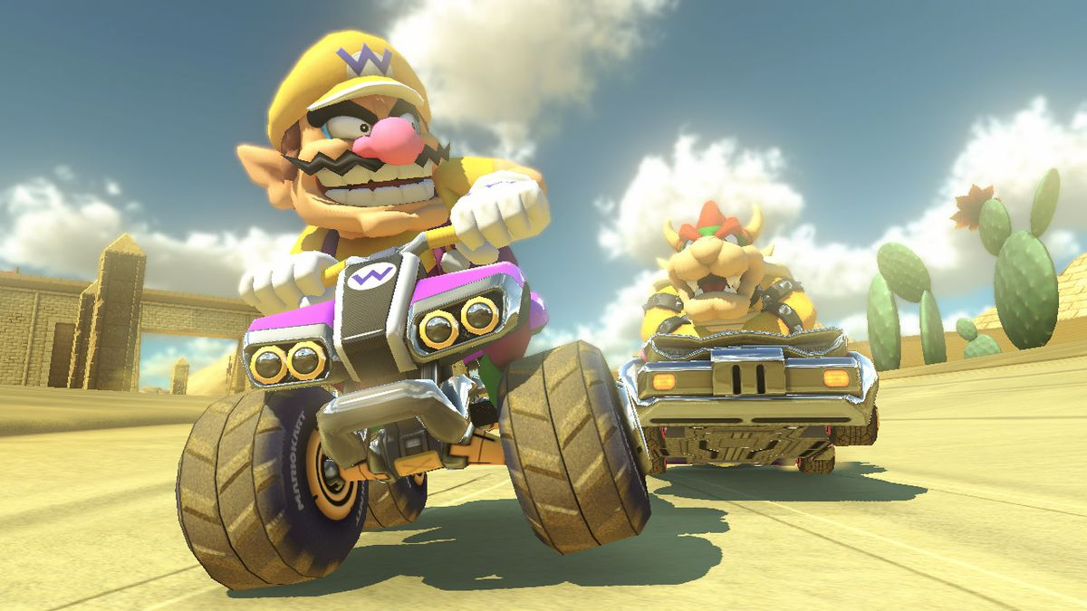 Wario and Bowser ride around in Mario Kart