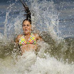 Rough surf at Croatan Beach, in Virginia Beach, Virginia stirred up by Hurricane Bill off the east coast, surprises Katherine Marsh, age 14, of Chesapeake, VA.